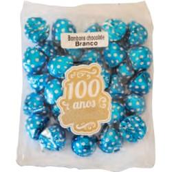 Small white chocolate bonbons in sachet
